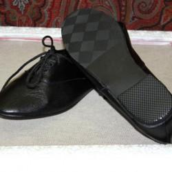 Zapatos negros planos regionales